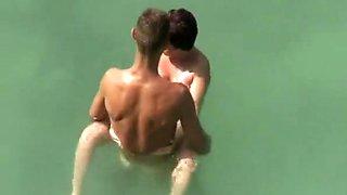 Big dick nude man fucks naked woman in water