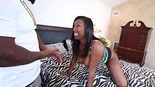 Stocky black guy satisfies big-assed beauty in bedroom