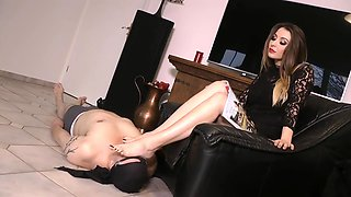 The lucky slave spends under the feet of his mistress human footstool