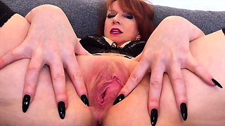 Busty mature redhead Red XXX stretches her pussy wide