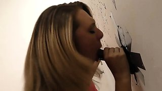 Brooke Wylde plays with two black cock in a gloryhole