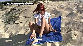 Sexy teen with a nice ass is on the beach and flashing her