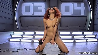 Redhead ebony squirter fucks machine
