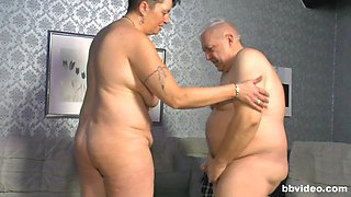 Chubby amateur mature couple enjoys having sex in the living-room
