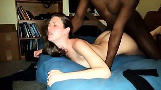 Cute brunette has a black bull hammering her cunt doggystyle