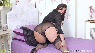 Busty brunette Eva Johnson strips wanks in sheer nylon heels
