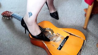 Hot amateur foot fetishist in high heels destroys a guitar