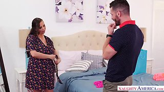 Tattooed milf, Sydney Leathers is riding a young guy's hard cock, while on the sofa