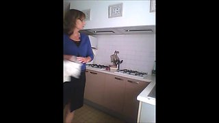 Spy Mature Woman in kitchen