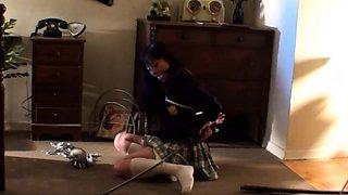 Sexy Asian schoolgirl in uniform learns a lesson in bondage