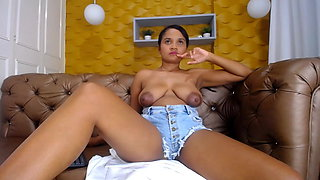 Young Latina Zara puts her big tits and nipples in your face