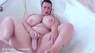 Chubby Girl With Bald Pussy Masturbates In The Bathtub