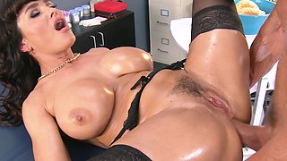 A milf gets fucked by her patient in the nurses office in the cunt