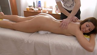 Slender brunette babe gets a massage and sexy toy
