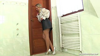 Bubbly milf in stockings takes an orgasmic ride on a stiff cock