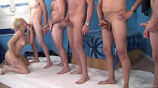 Hot woman gets her tiny holes enlarged by a bunch of men