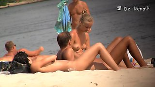 Naked people are having some good time on the beach