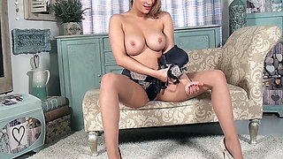 Pretty all natural busty blonde Penny Lee shows it all teasing in tan nylons sexy panties and heels