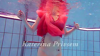 Russian Ariel shows striptease under the water