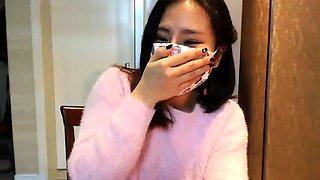 Sexy Asian babe in tight panties sensually touches herself