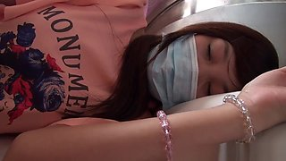 Sexy Chinese girl in nylon stockings wakes up from a deep sleep and delivers a footjob